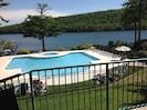 condo overlooks condo pool, spa and lake