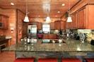 Fully stocked kitchen:  granite, stainless steel, Mr coffee, Keurig, & Cuisinart