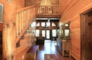 Entranceway: Vaulted ceilings.  French doors opening to deck overlooking lake