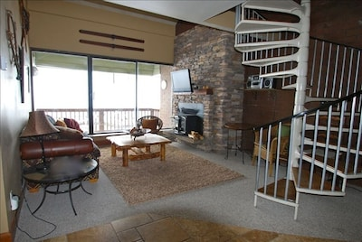 Living room, fireplace and flat screen tv