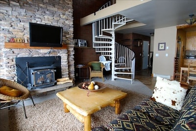 Living Room with fireplace and wall mounted flat screen tv