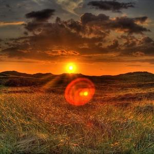 Sonnenuntergang in den Dünen.
