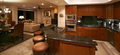 Kitchen overlooking dining and living area