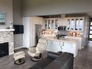 Kitchen and Great Room with large screen television and cable