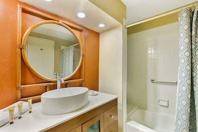 Custom Marble Vanity and Mirror in Bathroom with Shower/Tub