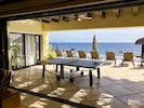 Shaded ping-pong table with ocean view
