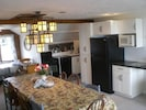 Topside kitchen with dining table for ten