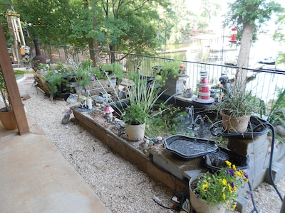 Sit with the koi ponds overlooking the lake from your porch