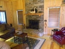 Living area with fireplace, which has gas fire logs