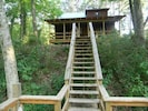 Back of cabin, midway down steps to river