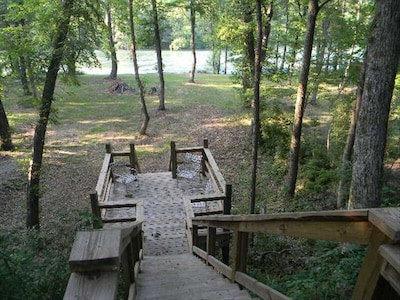 View from back of cabin, top of steps to river