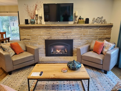 Rain or shine the cozy fireplace area offers comfort and relaxation.