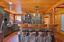 Kitchen with custom concrete countertops, stainless steel high end appliances