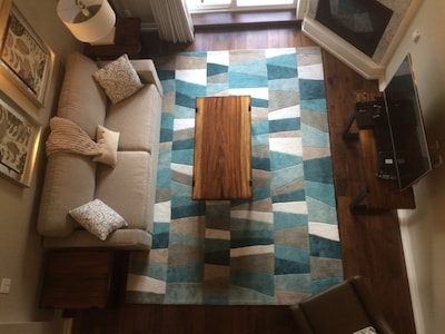 Over head shot of the living room from the master bedroom loft