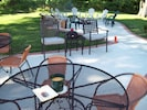Large patio and firepit, with plenty of seating.