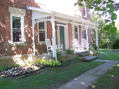 Relax on the front porch or enjoy the view of the wooded lot surrounding the Inn