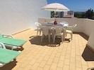 The apartment has a large roof terrace with table and sunloungers