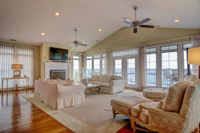 Third floor living room with covered deck and water view