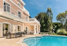 the heated pool at Villa Monaco with 16 sunbeds