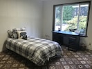 The downstairs bedroom features a twin trundle bed which easily pulls out.