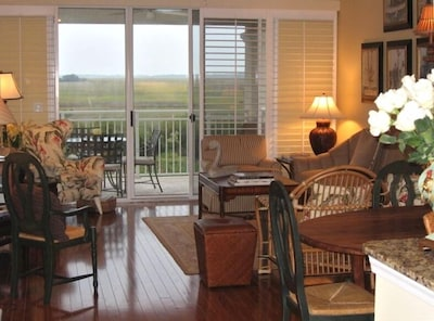 Living Room and spectacular East Marsh view toward Sea Island from Balcony