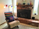 Gas Fireplace with cheerful decor.