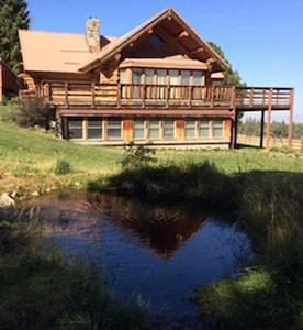 Good Bear Ranch house view from Little Bear Creek.
