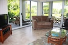 Bright Ground Floor With Lush Tropical Vegetation.  Walk Off Lanai To Pool.