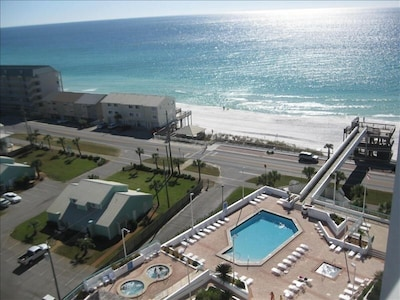 Balcony view of the spacious pool deck and skybridge over to the beach tower.