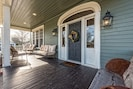 Enjoy a glass of wine or a cup of coffee on the relaxing porch.