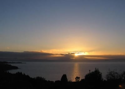 Deck view of sunset over Lake Taupo