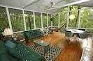Screened in Porch with Glider Couches & Hammock