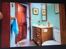 Split bathroom from kitchen and Master Bedroom.  Convenient and private.