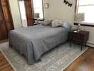 First floor master bedroom with queen bed.  New white oak flooring and rug.