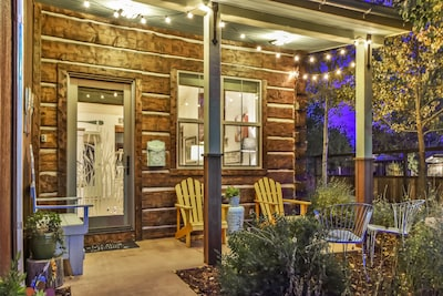 Front porch at nighttime with fully fenced yard/gate.