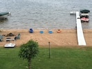 view from deck of sandy beach and dock