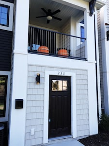 The front entryway with a relaxing porch above.