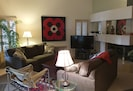Living room with cathredal ceilings.