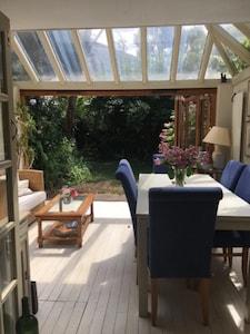 Garden rOne of our three ground floor rooms opens fully, onto a verdant garden.
