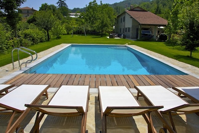 Private pool with villa in background.
