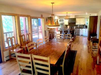 Dining area/Great room. 3 sliding glass doors to outside deck with views and bbq