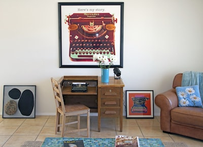 Living room features antique typewriter desk & machine. Use it or setup computer