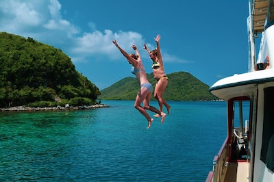 Leap from the top of the Elixir into pristine Caribbean waters