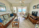 Living room with gorgeous views and access to veranda and beach.
