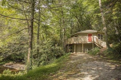 The River House rental sits along the Horsepasture River in Sapphire, NC.