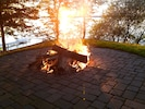 Large fire pit with wooden swing. We supply the wood!