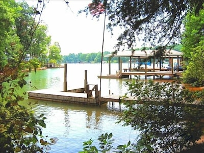 Both docks are for your use. Large covered dock has 36ft length, & 24ft for boat