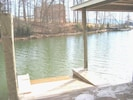 Floating jet-ski dock & water level access to in the slip for your boat.