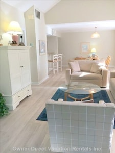 Bright and spacious living and dining rooms overlook a lovely lagoon.