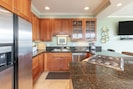 Fully Stocked Gourmet Kitchen w/ open floor plan w/ balcony views and BBQ
